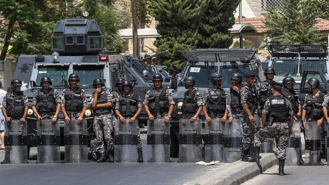 Jordanian security forces on guard before protesters near the Israeli embassy in Amman on July 28, 2017. (AFP)