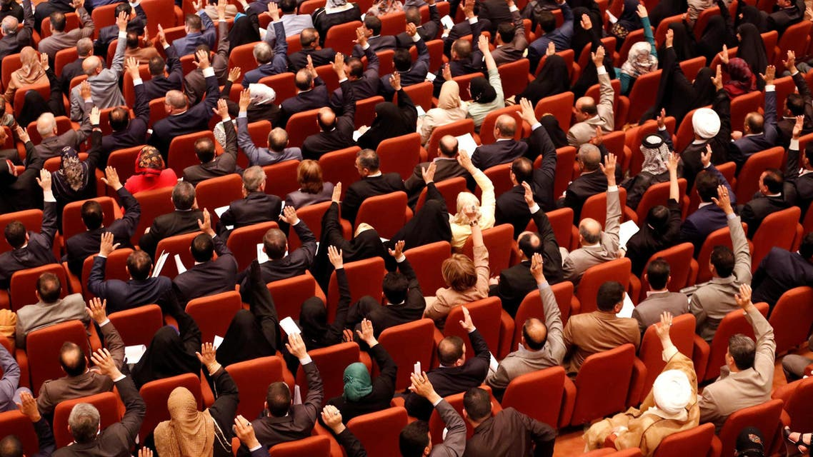 Members of the Iraqi parliament gather to vote on new government at the parliament headquarters in Baghdad on September 8, 2014. (Reuters)