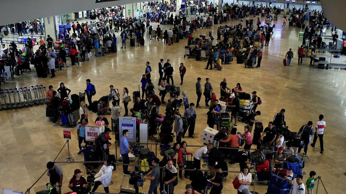 Passengers wait for their flights inside the Ninoy Aquino International Airport  terminal 1 in Pasay city, metro Manila, Philippines. (Reuters)