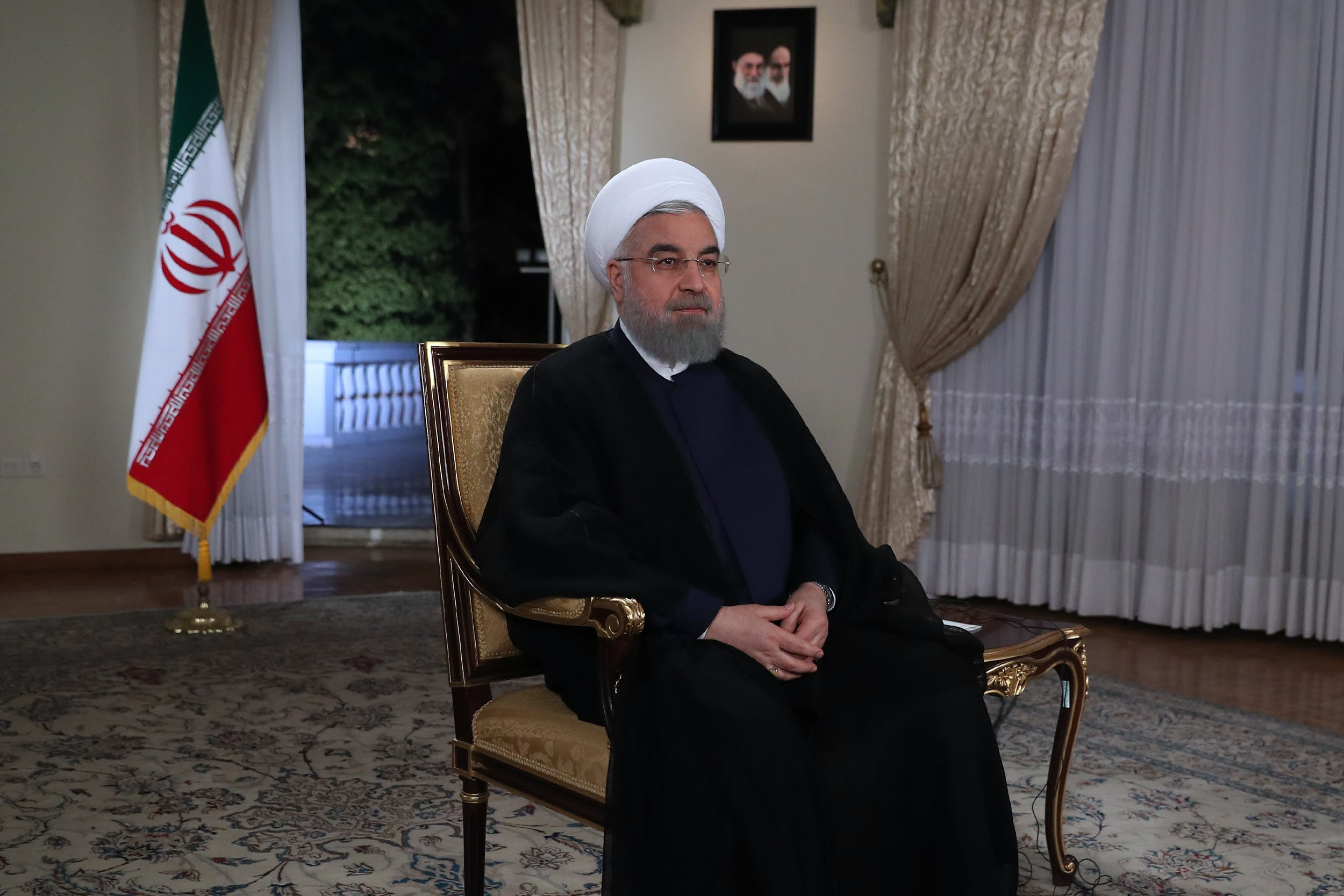 A handout picture provided by the office of Iranian President Hassan Rouhani on August 29, 2017, shows him during a live TV broadcast interview in Tehran. (AFP)