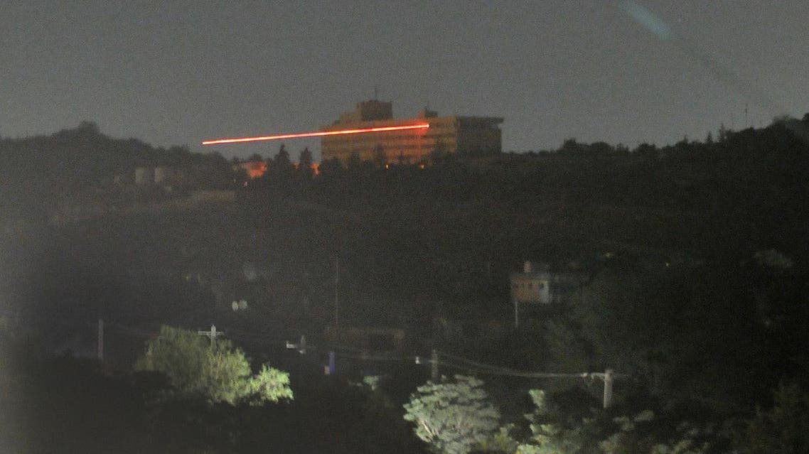 The Inter-Continental hotel in seen in the dark as tracer bullets are shot during an attack in Kabul on June 29, 2011. (AFP)