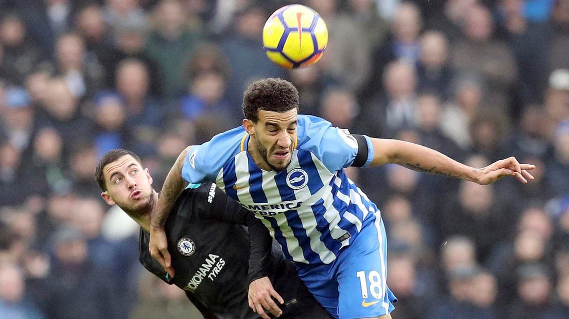 Chelsea's Eden Hazard (left), and Brighton & Hove Albion's Connor Goldson in action in Brighton, England, ony Jan. 20, 2018. (AP)