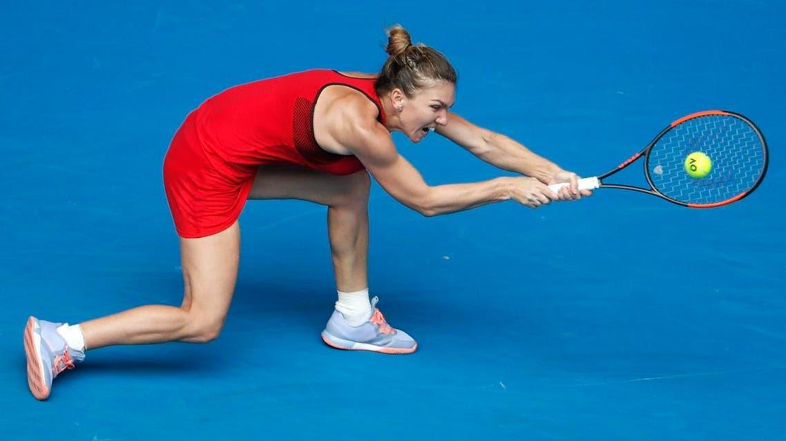 Simona Halep of Romania hits a shot against Lauren Davis. (Reuters)