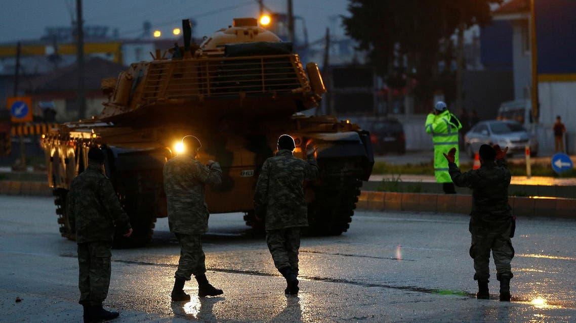A Turkish convoy arrives at a military base in Rihanli, near the Turkish-Syrian border, Hatay province, Turkey on January 17, 2018. (Reuters)