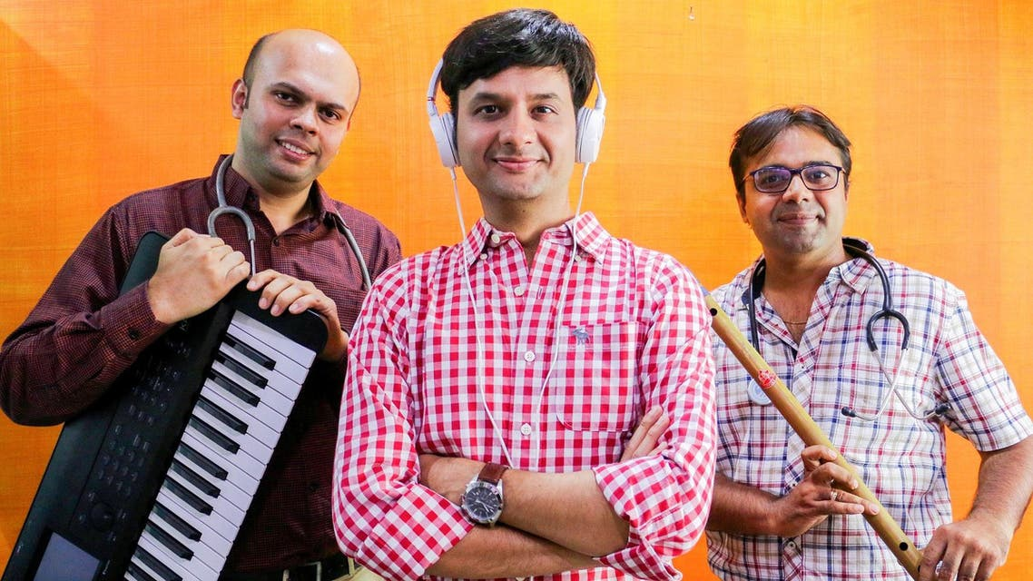 Dr Parth Mankad (extreme right), Dr Kedar Upadhyay (extreme left) and Dhvanit Thaker have set up Euphonious Healing Music Therapy Clinic and Research Centre in Ahmedabad. (Supplied)