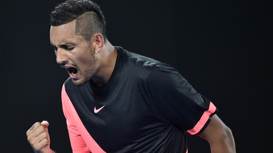 Nick Kyrgios reacts after a point against Grigor Dimitrov during their men's singles fourth round match on day seven of the Australian Open in Melbourne on January 21, 2018. (AFP)