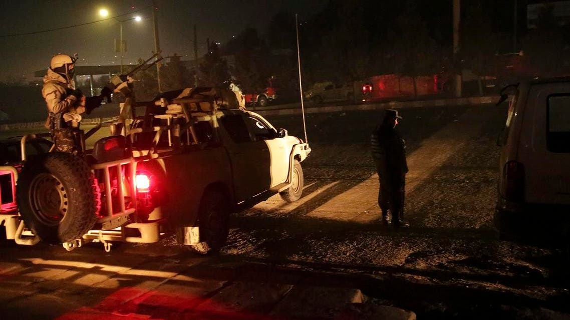 Security forces stand guard near the Intercontinental Hotel after a deadly attack in Kabul. (AP)