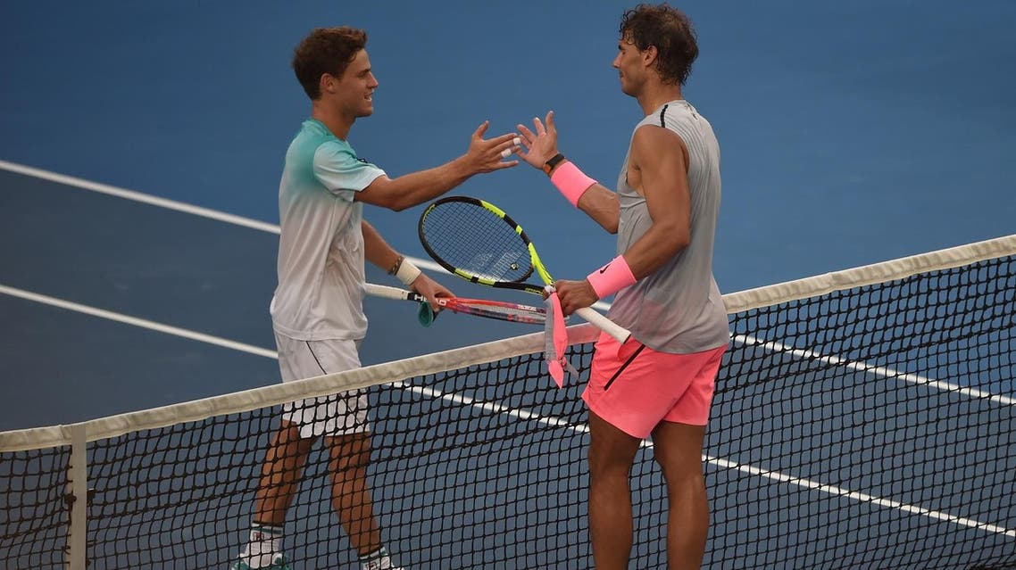 Spain's Rafael Nadal (R) talks to Argentina's Diego Schwartzman after their men's singles fourth round match on day seven of the Australian Open tennis tournament in Melbourne on January 21, 2018. (AFP)