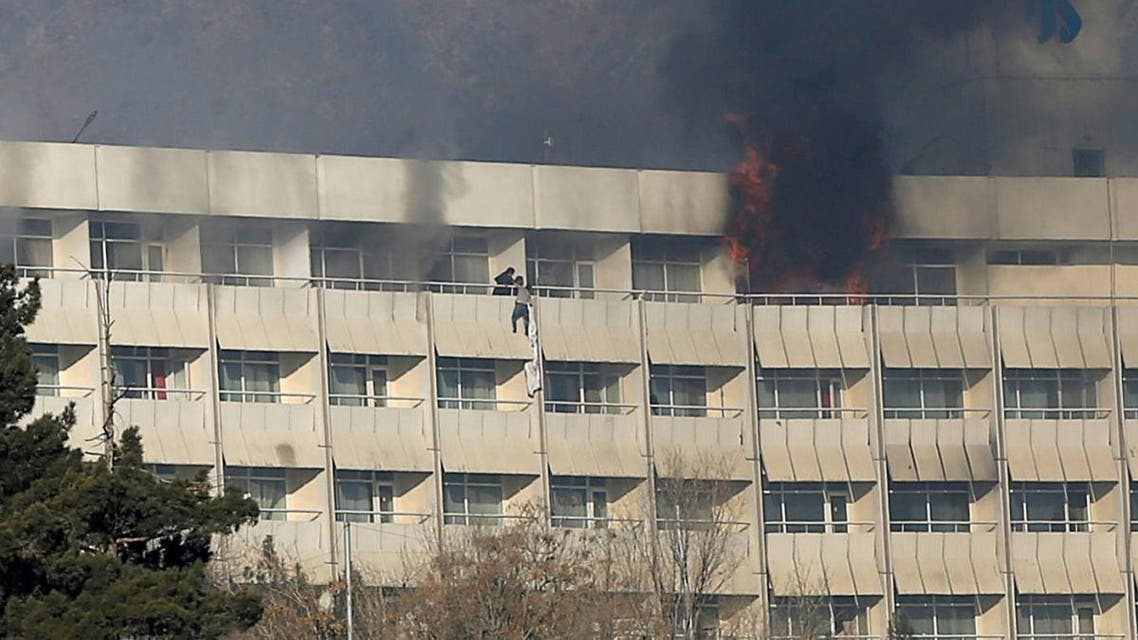 A man tries to escape from a balcony at Kabul's Intercontinental Hotel during an attack by gunmen in Kabul. (Reuters)