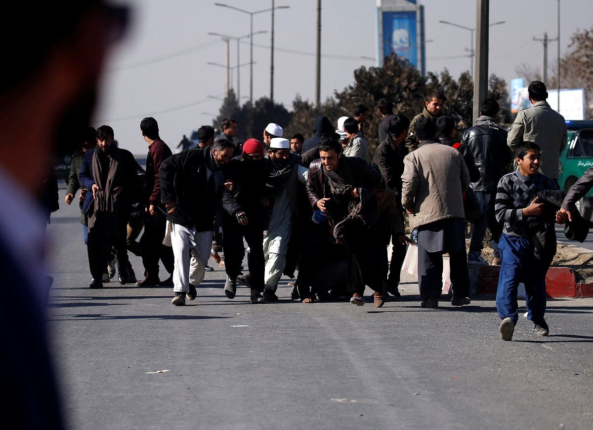 People escape during attack on Intercontinental Hotel in Kabul. (Reuters)