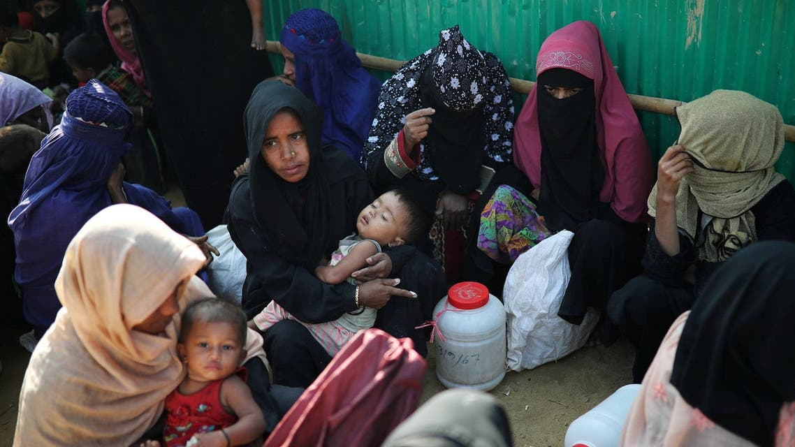 Rohingya refugee women wait outside of a medical center at Jamtoli camp in Cox's Bazar, Bangladesh, January 22, 2018. REUTERS/Mohammad Ponir Hossain