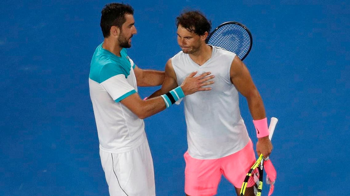 Marin Cilic of Croatia and Rafael Nadal of Spain embrace after Nadal retired from their match. (Reuters)