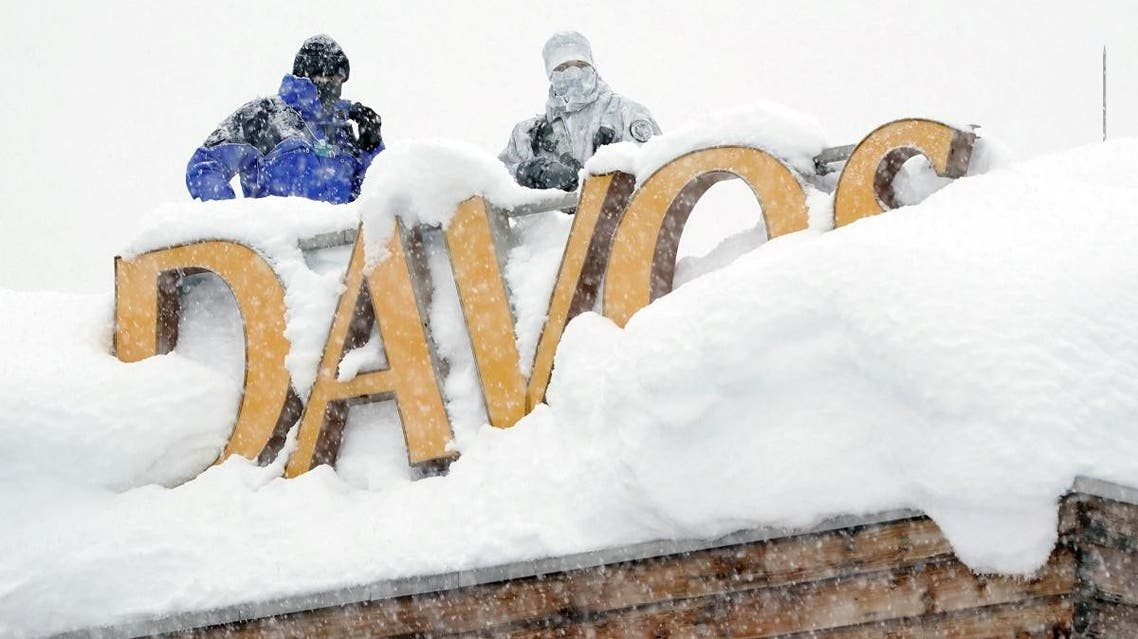 Snipers hold their position on the roof of a hotel during the World Economic Forum (WEF) annual meeting in the Swiss Alps resort of Davos, Switzerland. (Reuters)