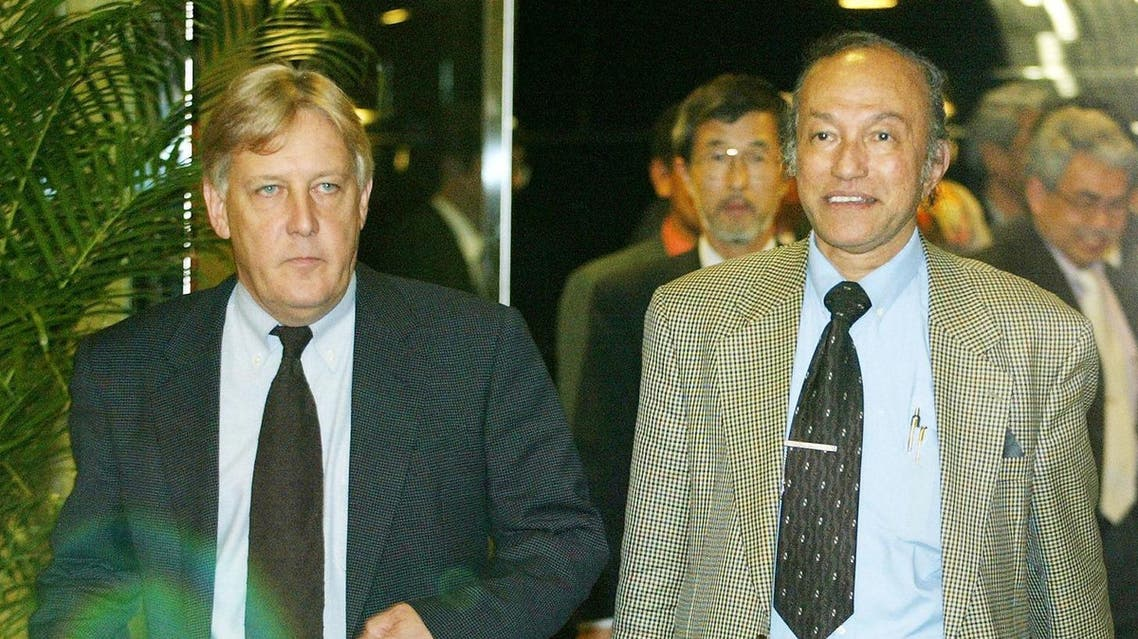 Head of the Free Aceh Movement (GAM) Malik Mahmud (R) is escorted by a mediator and chief of the Henry Dunant Center Martin Griffiths (L). (File photo: AFP)