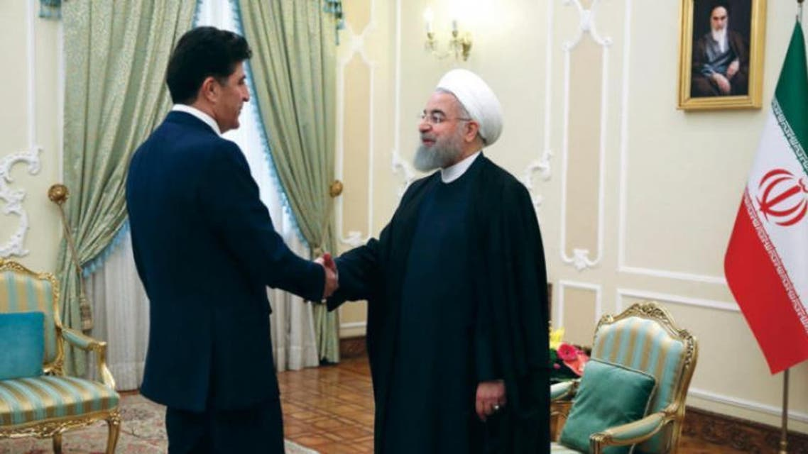 الرئيس الإيراني حسن روحاني لدى استقباله رئيس حكومة إقليم كردستان العراق نيجيرفان بارزاني