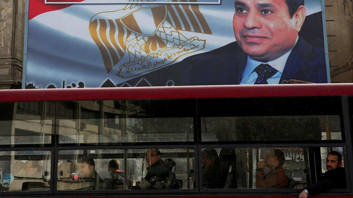 A transport bus passes in front of a banner advertising Egyptian President Abdel Fattah al-Sisi's electoral campaign in Cairo on January 22, 2018. (Reuters)