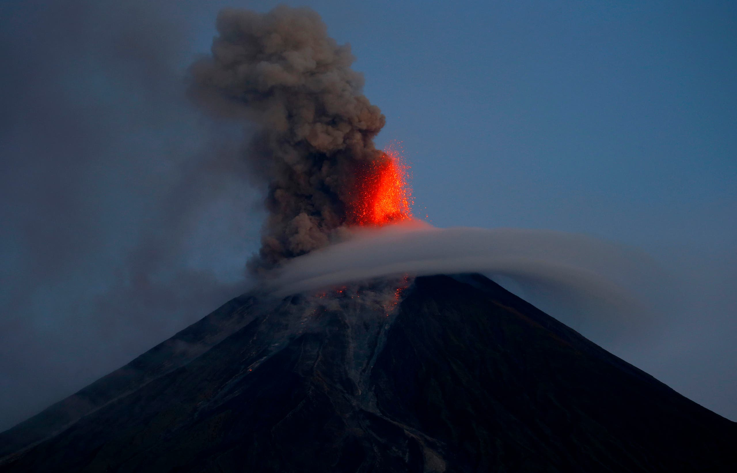 Mayon volcano spews red-hot lava in another eruption as seen from Legazpi city, Albay province, around 340 kilometers (200 miles) southeast of Manila, Philippines, Wednesday, Jan. 24, 2018.
