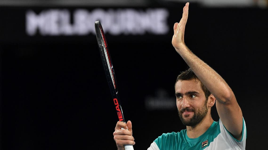 Croatia's Marin Cilic celebrates beating Britain's Kyle Edmund in their men's singles semi-finals match on day 11 of the Australian Open tennis tournament in Melbourne on January 25, 2018. (AFP)