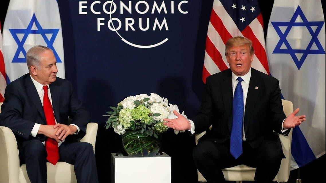 U.S. President Donald Trump speaks with Israeli Prime Minister Benjamin Netanyahu during the World Economic Forum (WEF) annual meeting in Davos, Switzerland January 25, 2018. (Reuters)