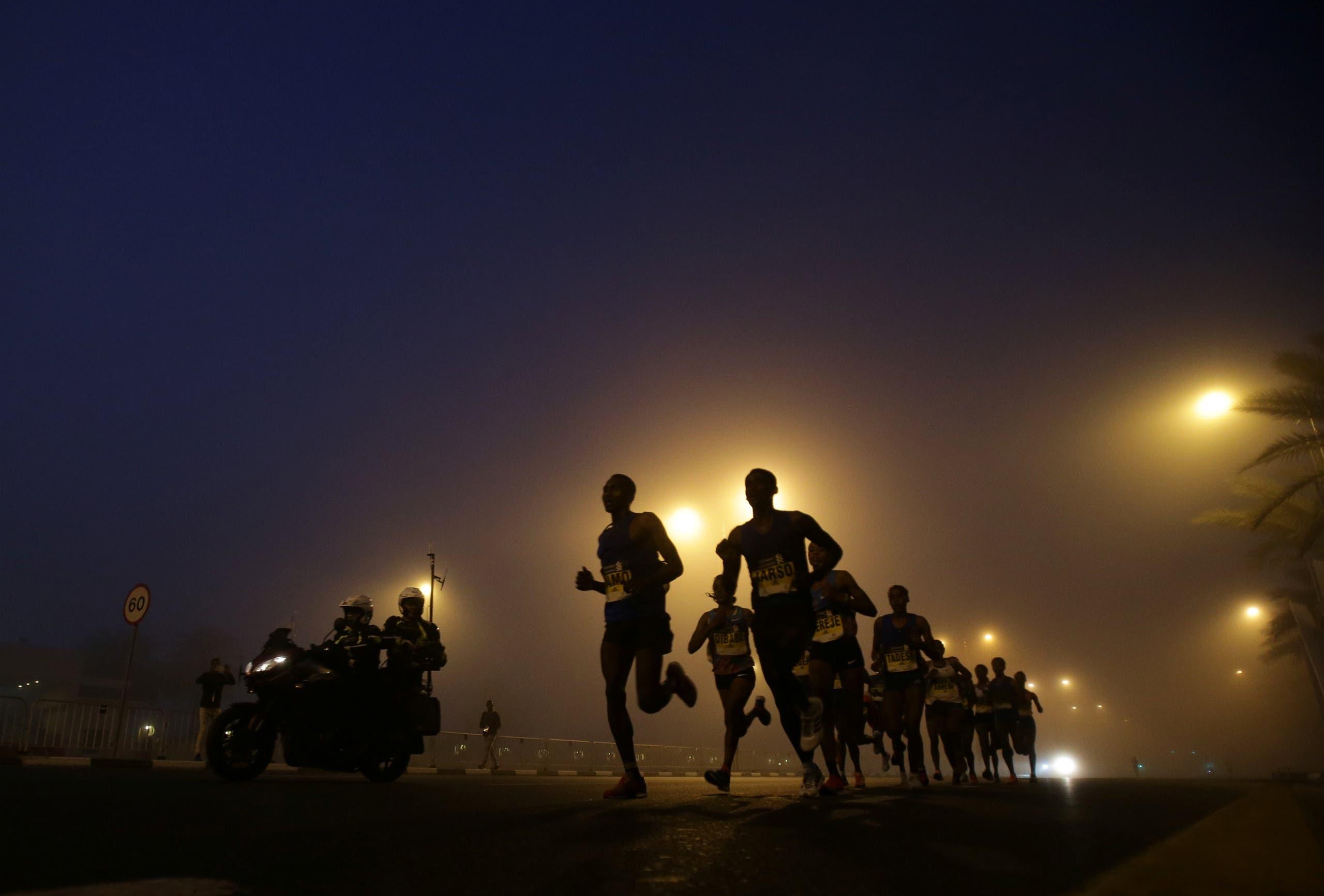 Athletes compete during the Dubai Marathon in Dubai, UAE January 26, 2018. REUTERS