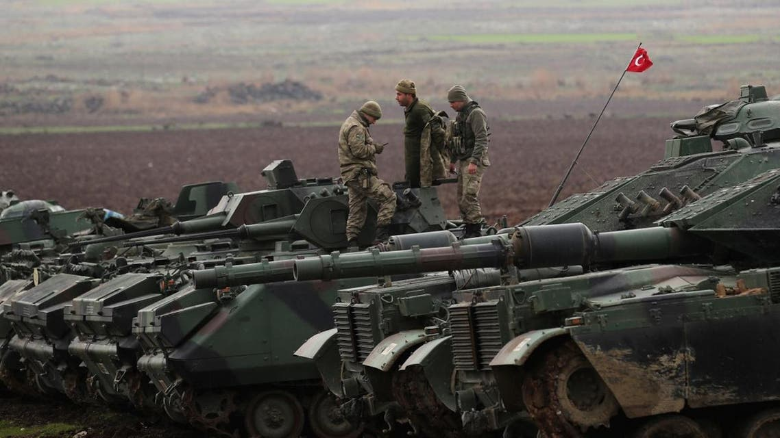 Turkish army tanks and armoured personnel carriers (APC) are seen near the Turkish-Syrian border in Hatay province. (Reuters)