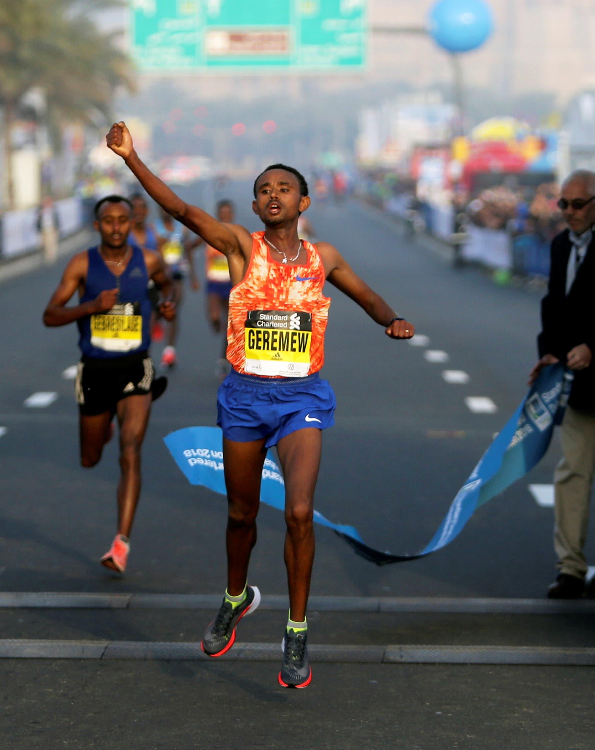 Geremew Bayih of Ethiopia crosses the finish line at the Dubai Marathon in Dubai, UAE January 26, 2018. REUTERS