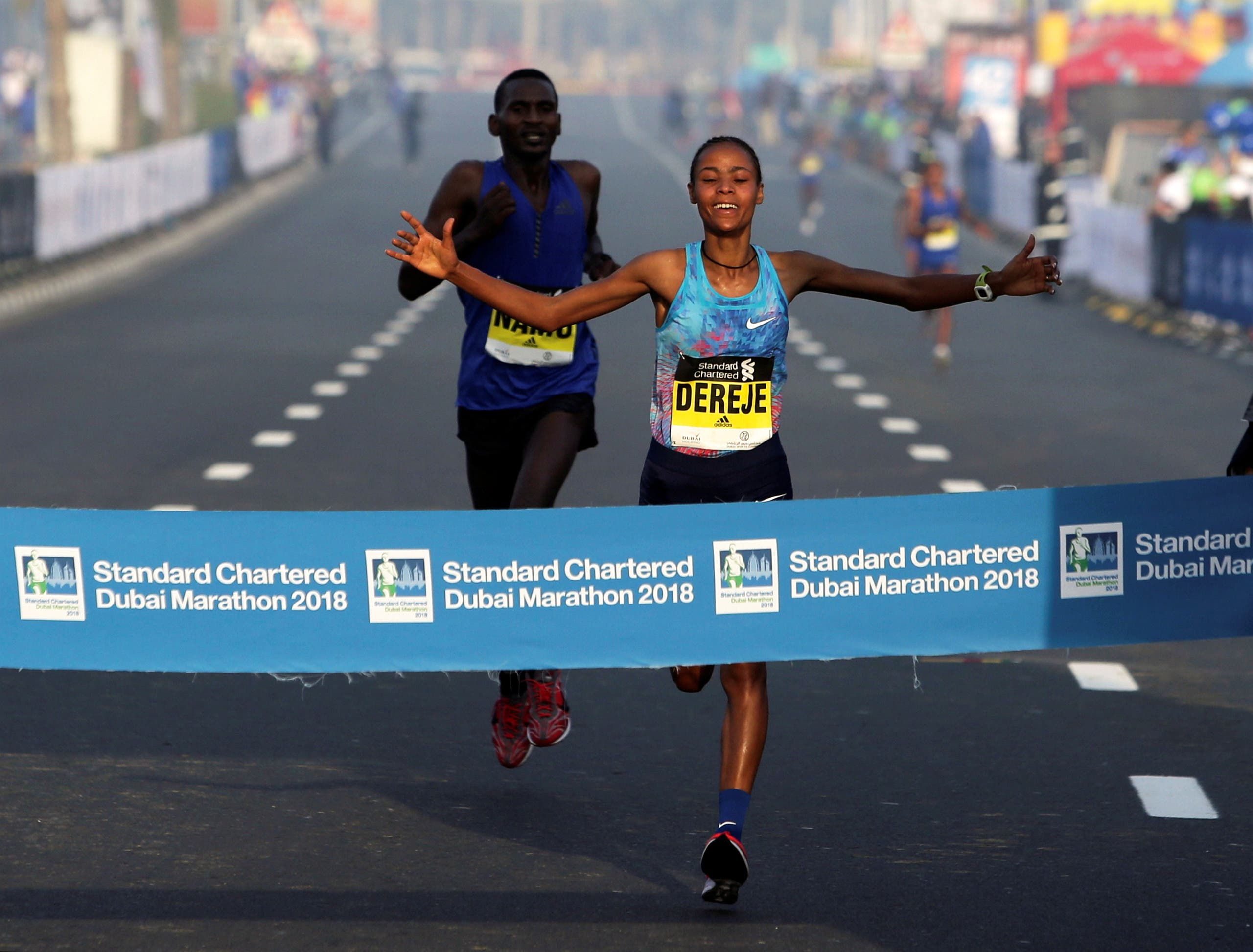 Roza Dereje Bekele of Ethiopia crosses the finish line of the Dubai Marathon, in Dubai, UAE January 26, 2018. REUTERS