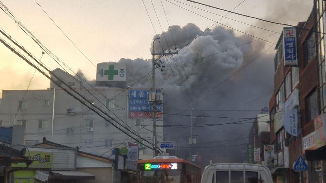 Smoke rises from a burning hospital in Miryang, South Korea. (Reuters)