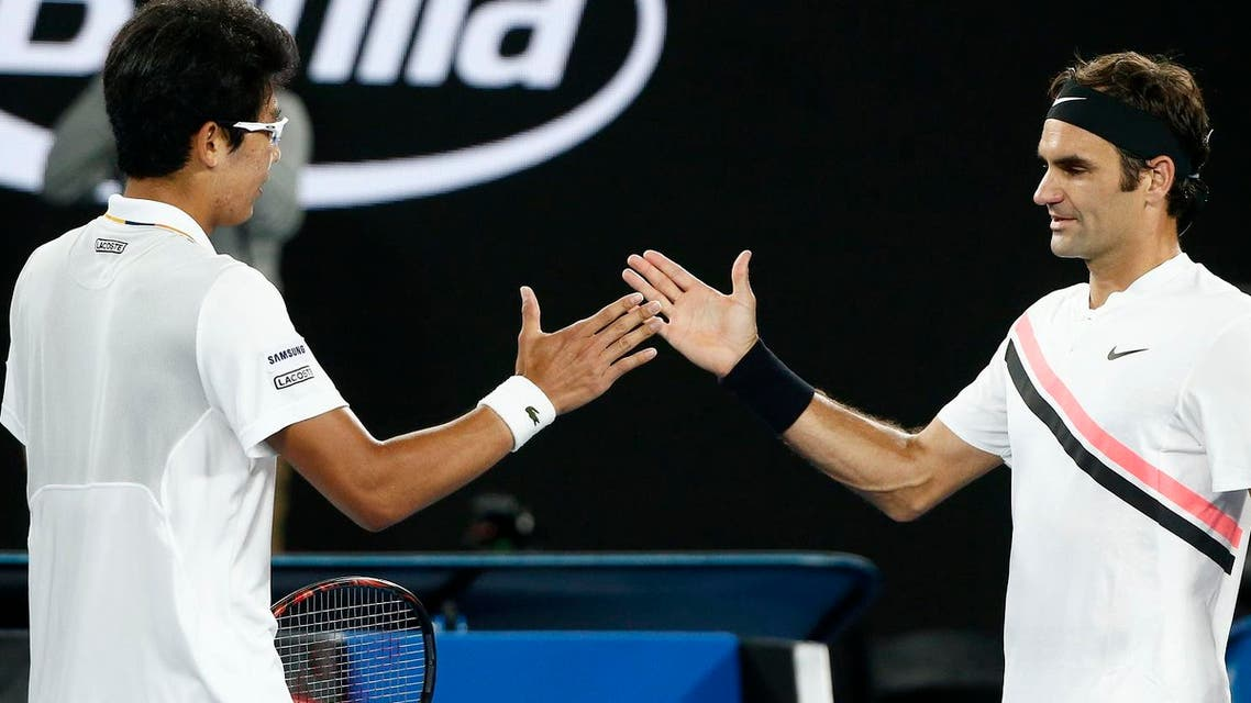 Chung Hyeon of South Korea shakes hands with Roger Federer of Switzerland after Chung retired from their match. (Reuters)