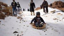 PHOTOS: Families enjoy day of sledding as snow drapes Saudi Arabian mountains