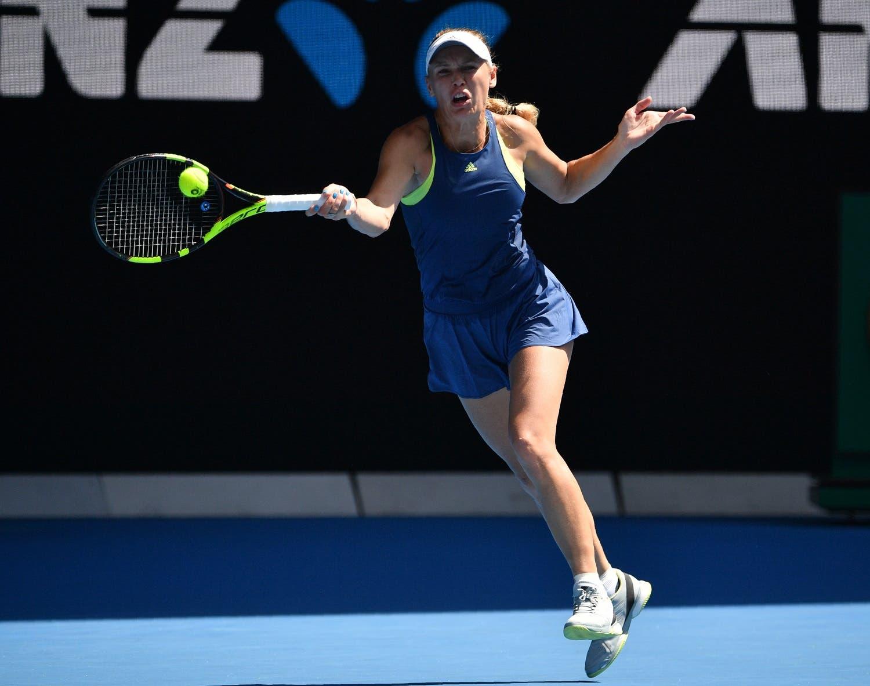 Caroline Wozniacki hits a return against  Elise Mertens during their women's singles semi-finals match of the Australian Open tennis tournament on January 25, 2018. (AFP)