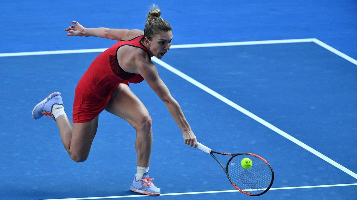 Simona Halep hits a return against Angelique Kerber during their women's singles semi-finals match on day 11 of the Australian Open tennis tournament in Melbourne on January 25, 2018. (AFP)
