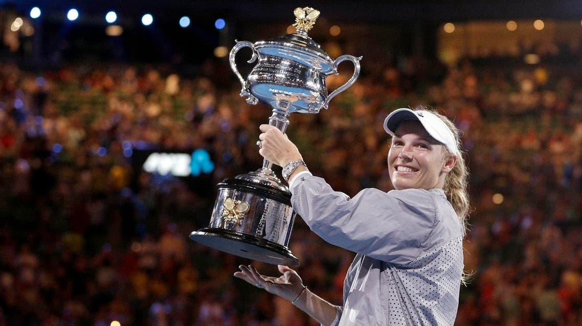 Caroline Wozniacki holds her trophy after defeating Simona Halep in the women's singles final at the Australian Open tennis championships in Melbourne, on Jan. 27, 2018. (AP )