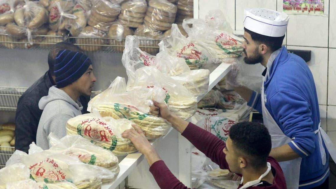 Jordanian buy bread from a bakery in the Jordanian capital Amman. (AFP)