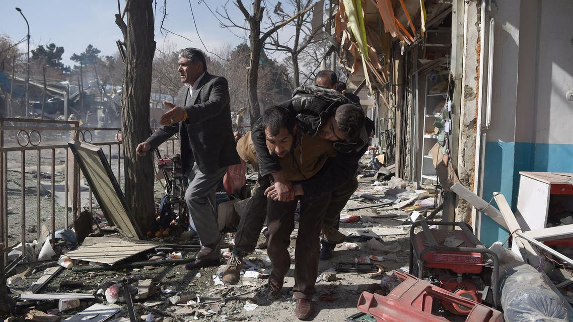 Afghan volunteers carry the body at the seine of a car bomb exploded in front of the old Ministry of Interior in Kabul on January 27,2018. (AFP)