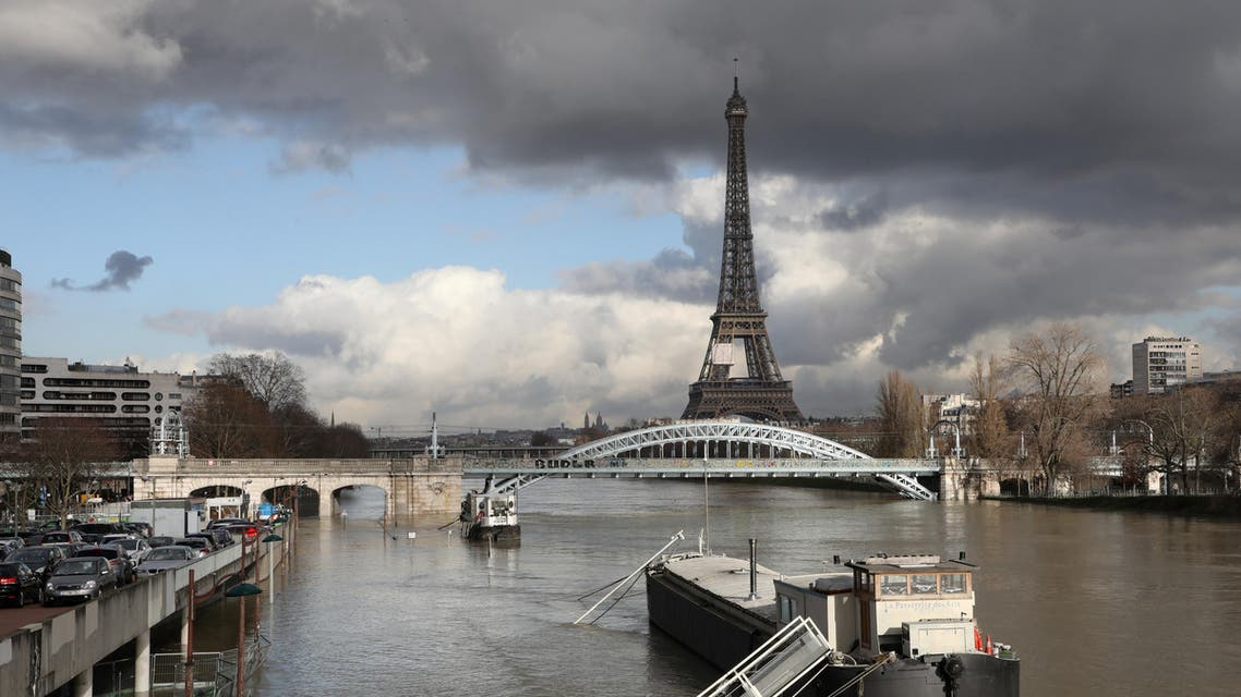 A picture taken on January 26, 2018, shows the flooded banks of the river Seine with the Eiffel Tower in the backround in Paris. (AFP)