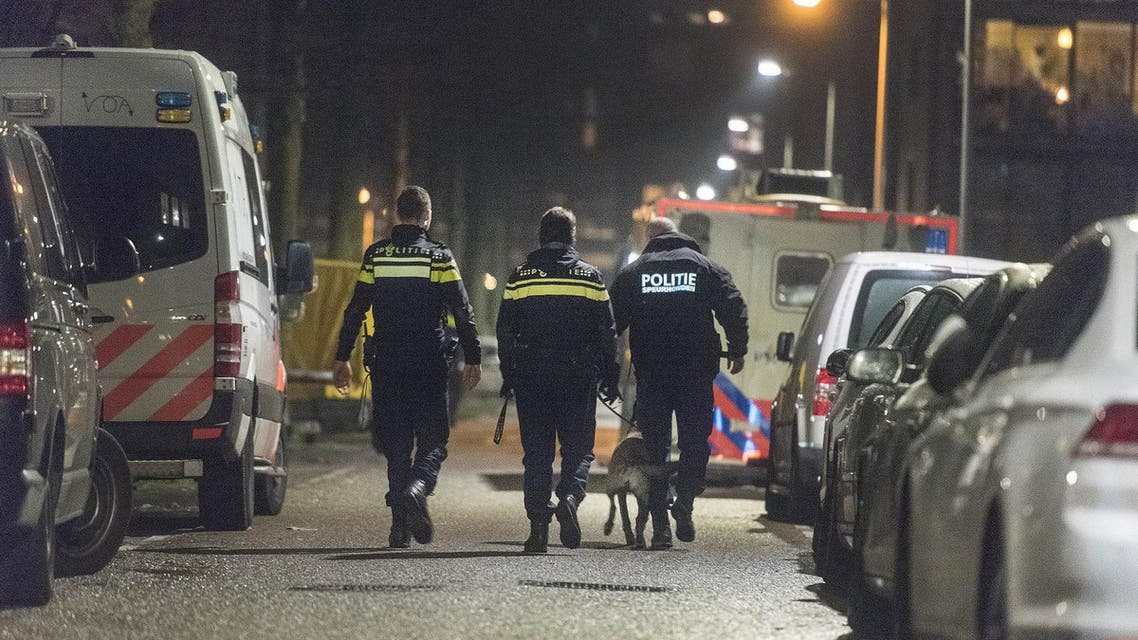 Policemen patrol a closed off lane following a shooting at the Grote Wittenburgstraat in Amsterdam on January 26, 2018. (AFP)
