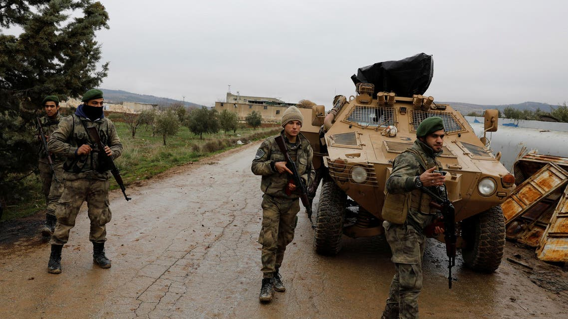 Members of Turkey-backed Free Syrian Army police forces secure the road as they escort a convoy near Azaz, Syria January 26, 2018. (Reuters)