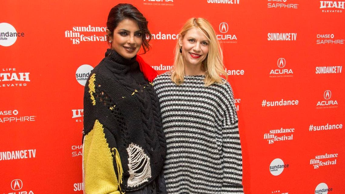 """Actresses Priyanka Chopra and Claire Danes pose during the premiere of the film """"A Kid Like Jake"""" at the Eccles Theatre during the 2018 Sundance Film Festival. (AP)"""