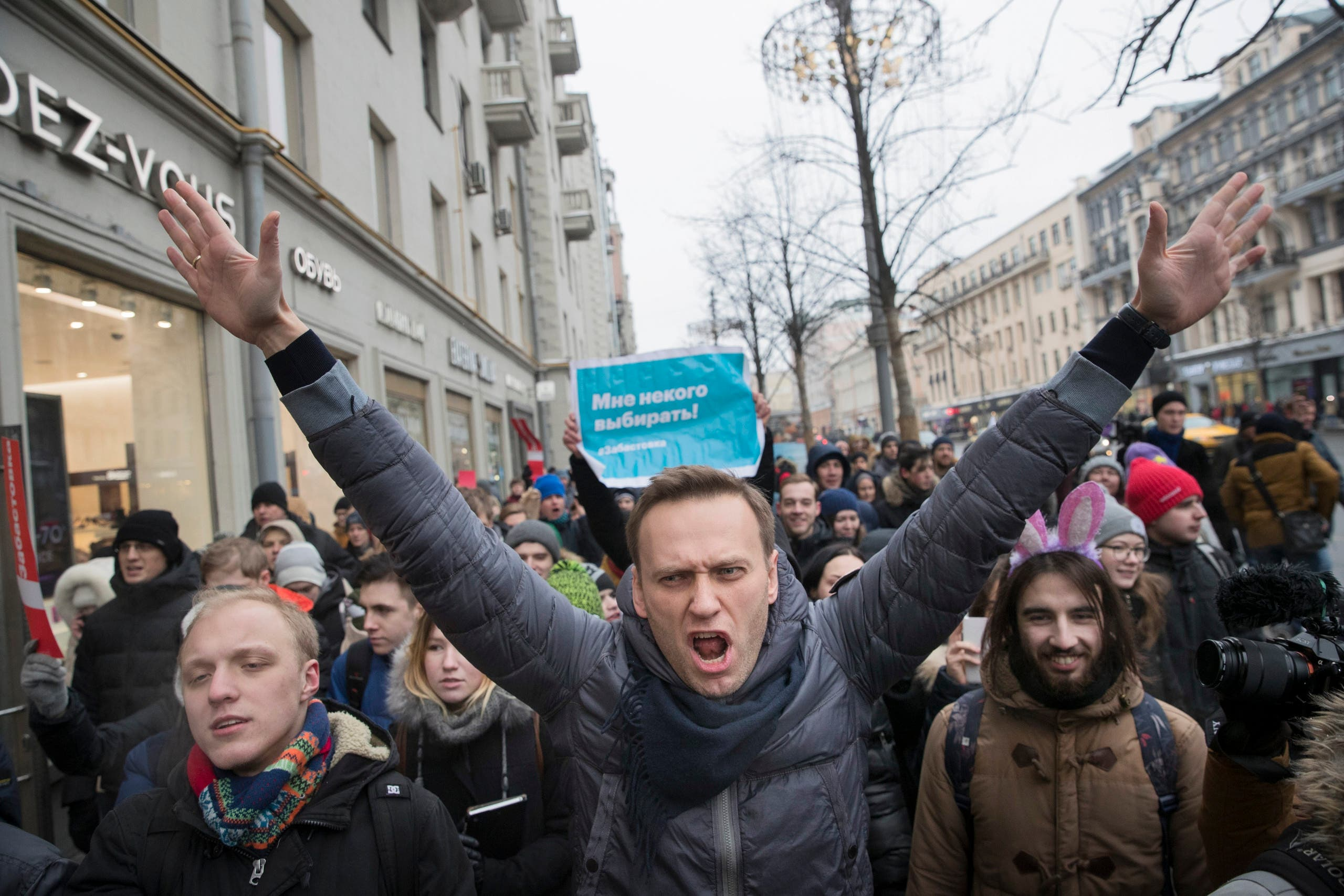 Russian opposition leader Alexei Navalny, centre, was arrested in Moscow while walking with protesters on January 28, 2018, as protests take place across the country. (AP)