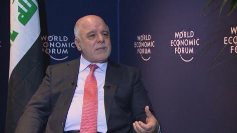 رئيس الوزراء العراقي حيدر العبادي مع تركي الدخيل