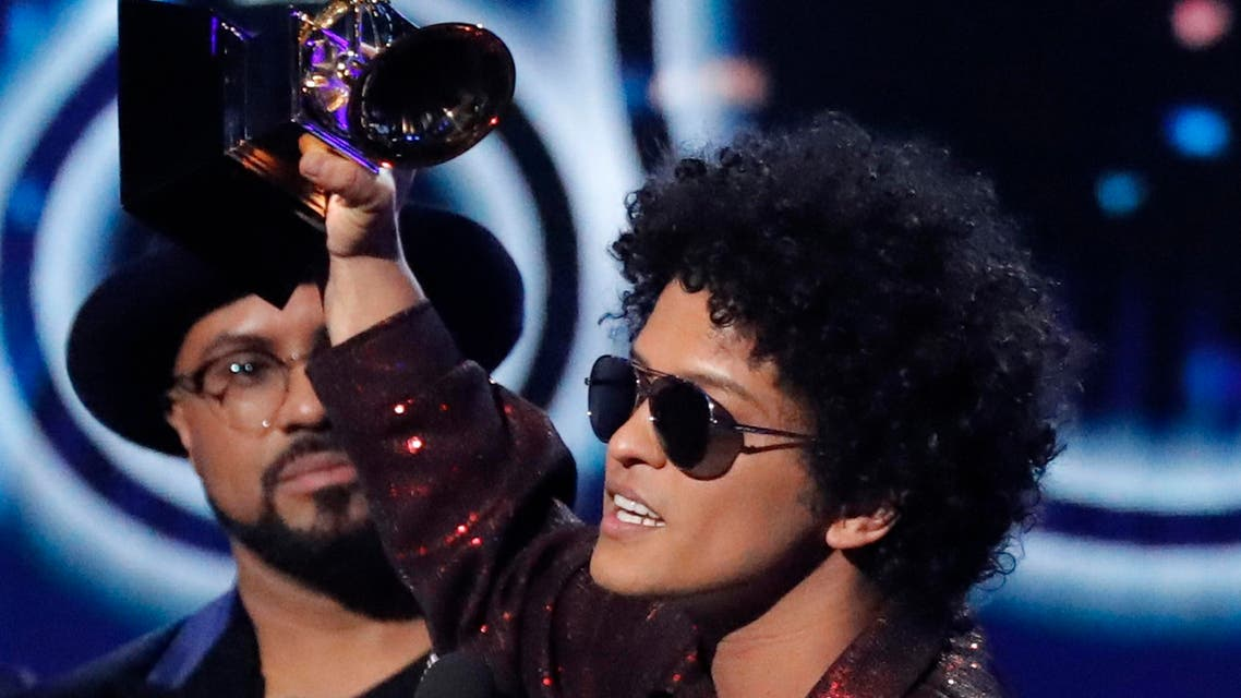 """Bruno Mars accepts the Grammy for record of the year for """"24K Magic."""" (Reuters)"""