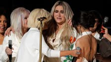 Kesha sings her heart out at Grammys in fierce anti-abuse statement