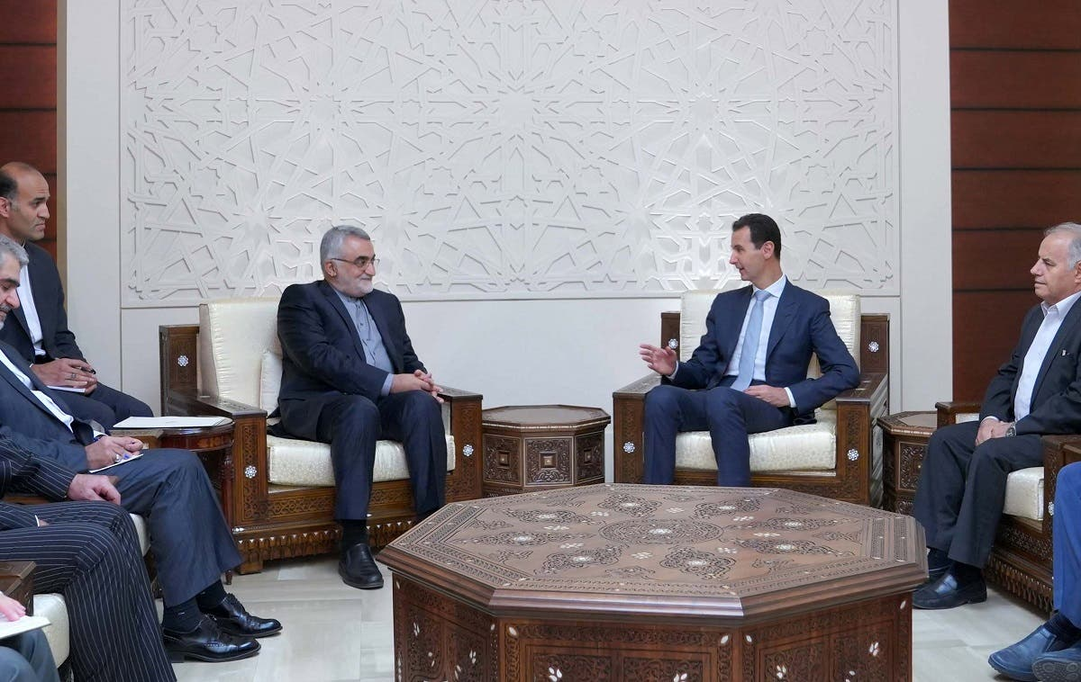 Syrian President Bashar al-Assad meets with the chairman of the Committee for Foreign Policy and National Security at the Iranian Shura Council Alaeddin Boroujerdi in Damascus on October 5, 2017.  LOUAI BESHARA / SANA / AFP