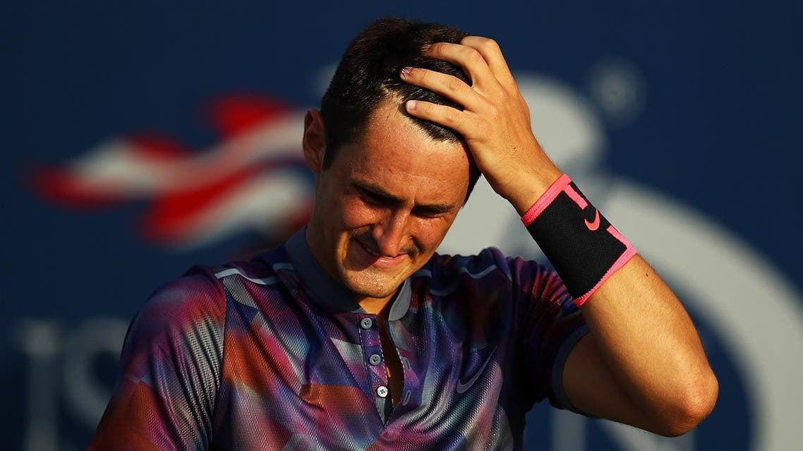 Bernard Tomic of Australia reacts during his first round Men's Singles match against Gilles Muller. (AFP)