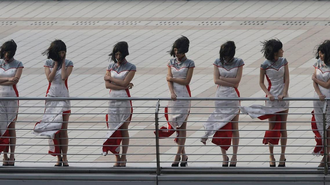 Grid girls wait to participate in the podium ceremony at the Chinese Formula One Grand Prix in Shanghai, China. (AP)