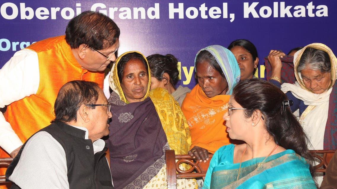 Bindeshwari Pathak (in waistcoat), Subrata Mukherjee and Sashi Panja with Sunderbans' tiger widows at a function organised by leading NGO, Sulabh International