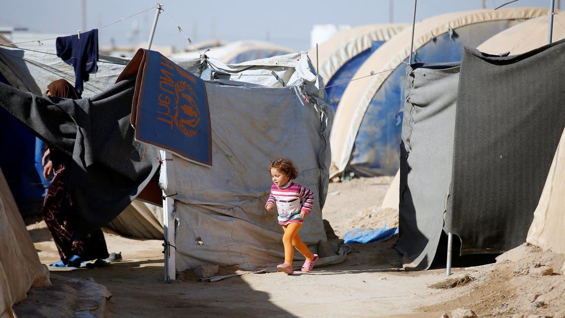 A displaced Iraqi girl plays at the Amriyat al Falluja camp in Anbar Province, Iraq January 3, 2018. Picture taken January 3, 2018. REUTERS/Khalid Al-Mousily