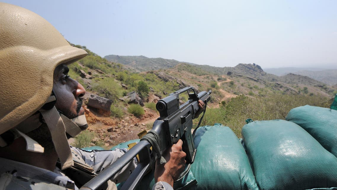 Saudi border guards keep watch along the border with Yemen in the al-Khubah area in the southern Jizan province on October 3, 2017. The post in al-Khubah, a deserted village framed by barren mountain ridges, is one of several border guard bases the Huthi-rebels have targeted in cross-border raids since a Saudi-led coalition began its military intervention in Yemen in 2015. Fayez Nureldine / AFP