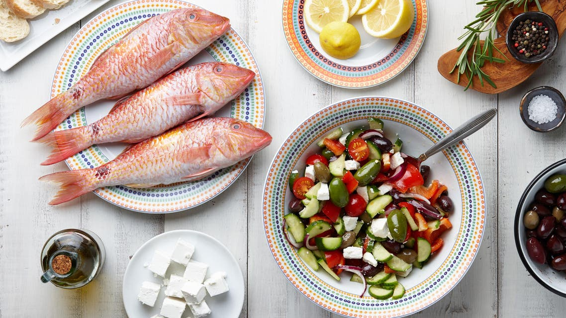 Red mullet fish and mediterranean dishes cooking - Stock image...